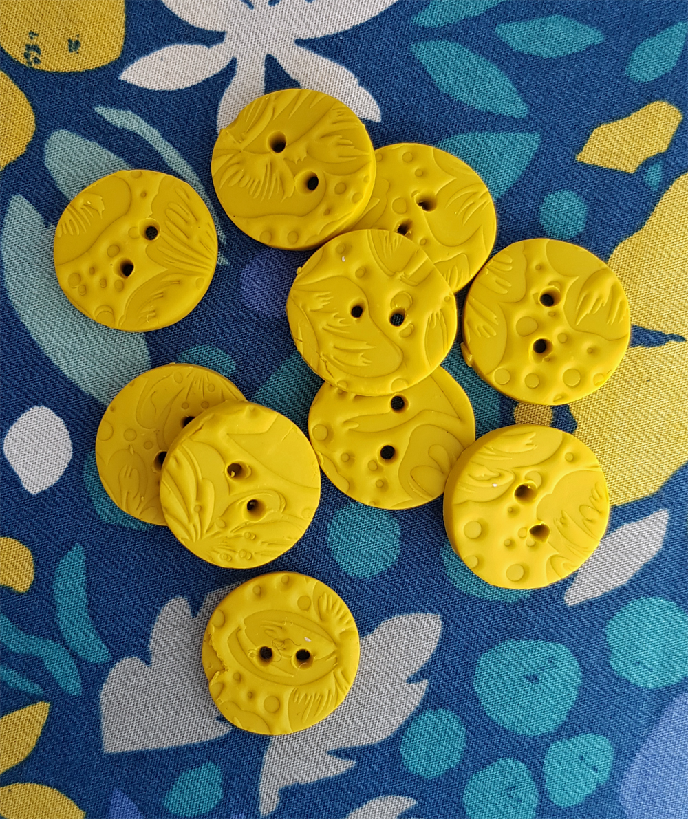 Yellow textured buttons
