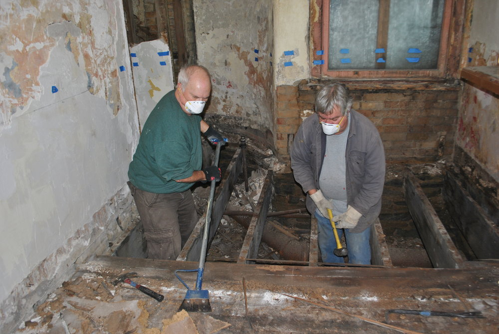 Bob and Chuck pulling out rotten flooring and molding