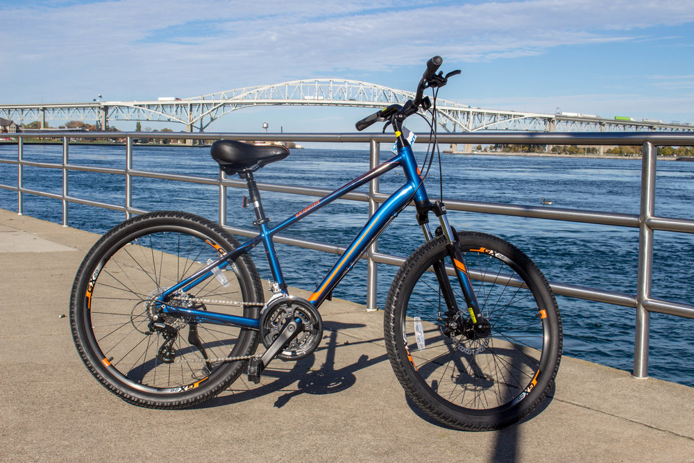 """Sedona is designed with the stable, confident stance of a mountain bike, including comfortable fat tires and upright positioning. But it's equally at home just cruising the streets. With a lightweight aluminum frame, available suspension for off-road excursions, and a broad range of gears, it's a bike that's always ready to keep the adventure going.""  - Giant"