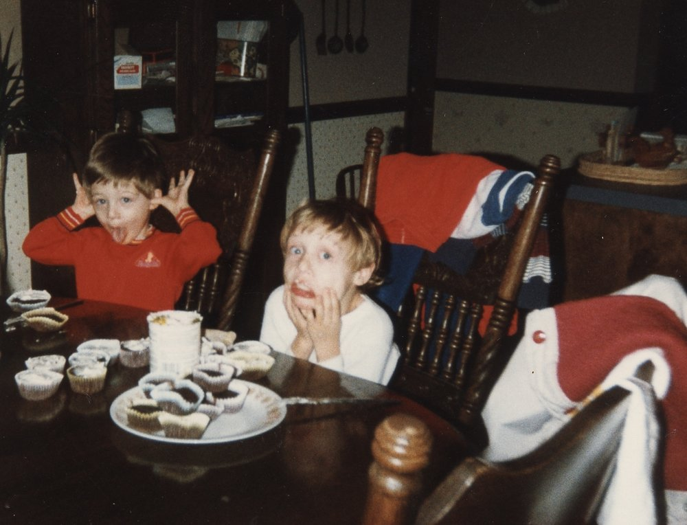 I'm on the left. My brother, Andy, clearly stole all the cupcakes from me.
