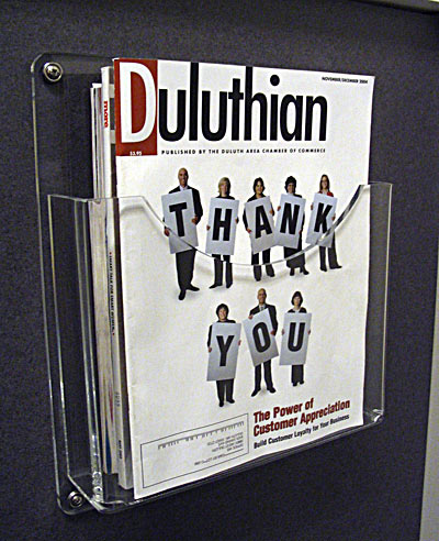 "Magazine Holder   Item #  1100-1250  Price:  $24.85 each  Dimensions:   11.00"" W x 12.50"" H x 2.50"" D Dim. O.D. Manufactured from 1/4"" clear acrylic. Pocket Dim:  10.00"" Wx7.75"" Hx2.00"" D ( I.D.) dimensions. Machined, polished edges. 4- hole mounting."