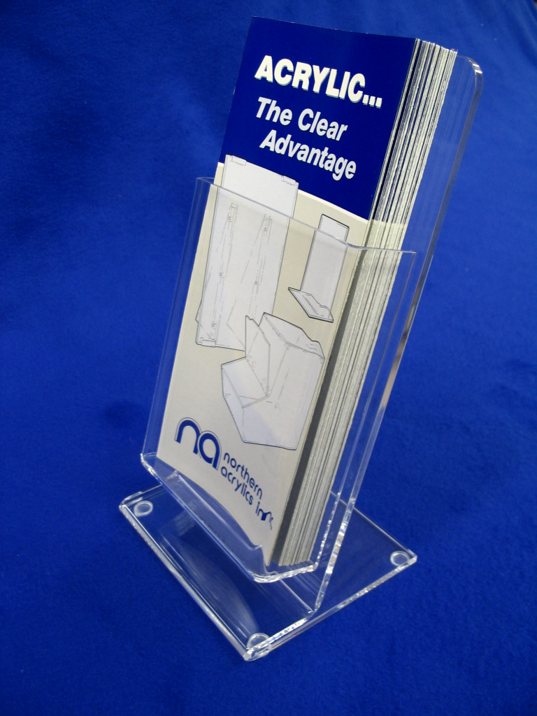 "4""x9"" Literature Holder   Item #  LH-4250  Price:  $9.95 each  Dimensions:  5.00"" W x 10.25"" H x 4.25"" D Dim. O.D. Table top brochure holder has a secure steady base. Constructed from 3/16"" and 1/8"" clear acrylic. Pocket is 4.25"" wide x 6.00"" tallx1.25"" depth. Polished edges, w/ clear non-skid feet on base."