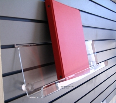 "18"" Slat Wall Book Shelf    Item #  SWBK6-18  Price:  $13.65 each  Dimensions:  6"" tall x 2"" depth x 18"" long Clear acrylic slat-wall book shelves with 1"" stand-off for slanted book display."