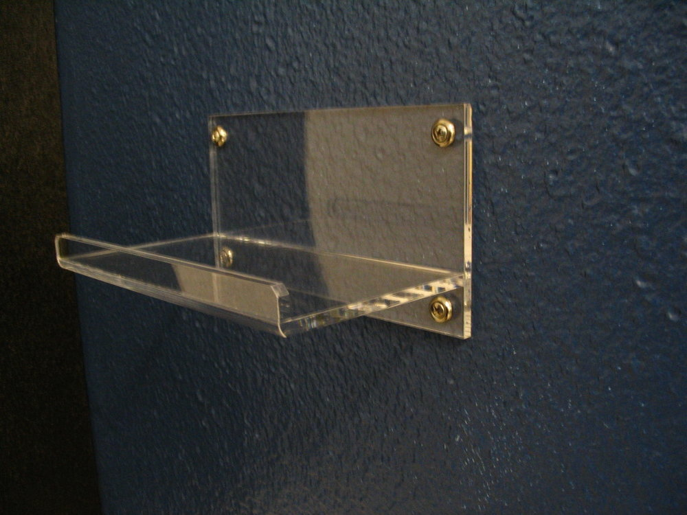"8"" Wall Mounted Shelf   Item #  WMS-8040  Price:  $13.50 each  Dimensions: 8.00"" W x 4.50"" D x 4.25"" H Dim. O.D. Display or organize personal items with this high quality shelf. Constructed from 1/4"" clear acrylic. Machined and polished edges. Many custom sizes available."