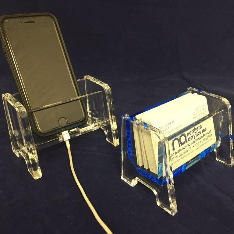 "Business Card Holder/Cell Phone Holder   Item #  BC-3750  Price:  $16.85 each  Dimensions:  4.437"" W x 3.00"" H x 2.75"" D Dim. O.D. Clear or blue acrylic business card holder or cell phone holder. Holds a 1"" stack of business cards or one cell phone. Laser cut; machine polished edges."