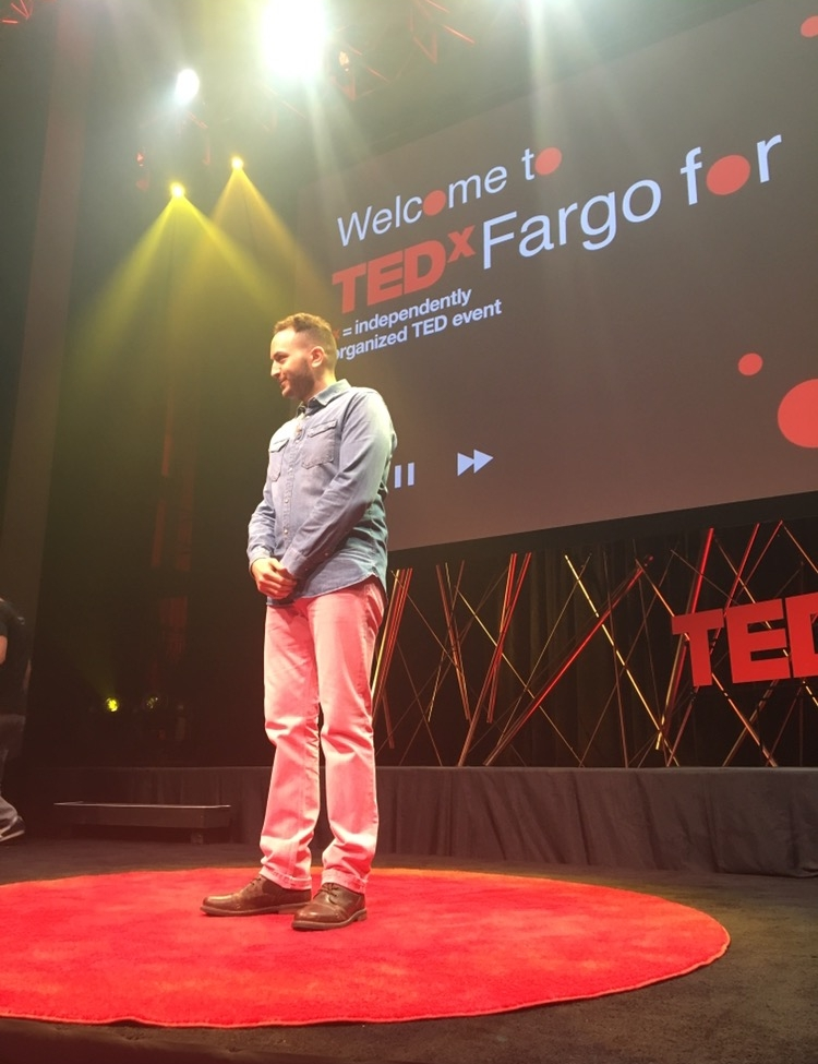 ali delivering his amazing ted talk and spoken word performance in Fargo.