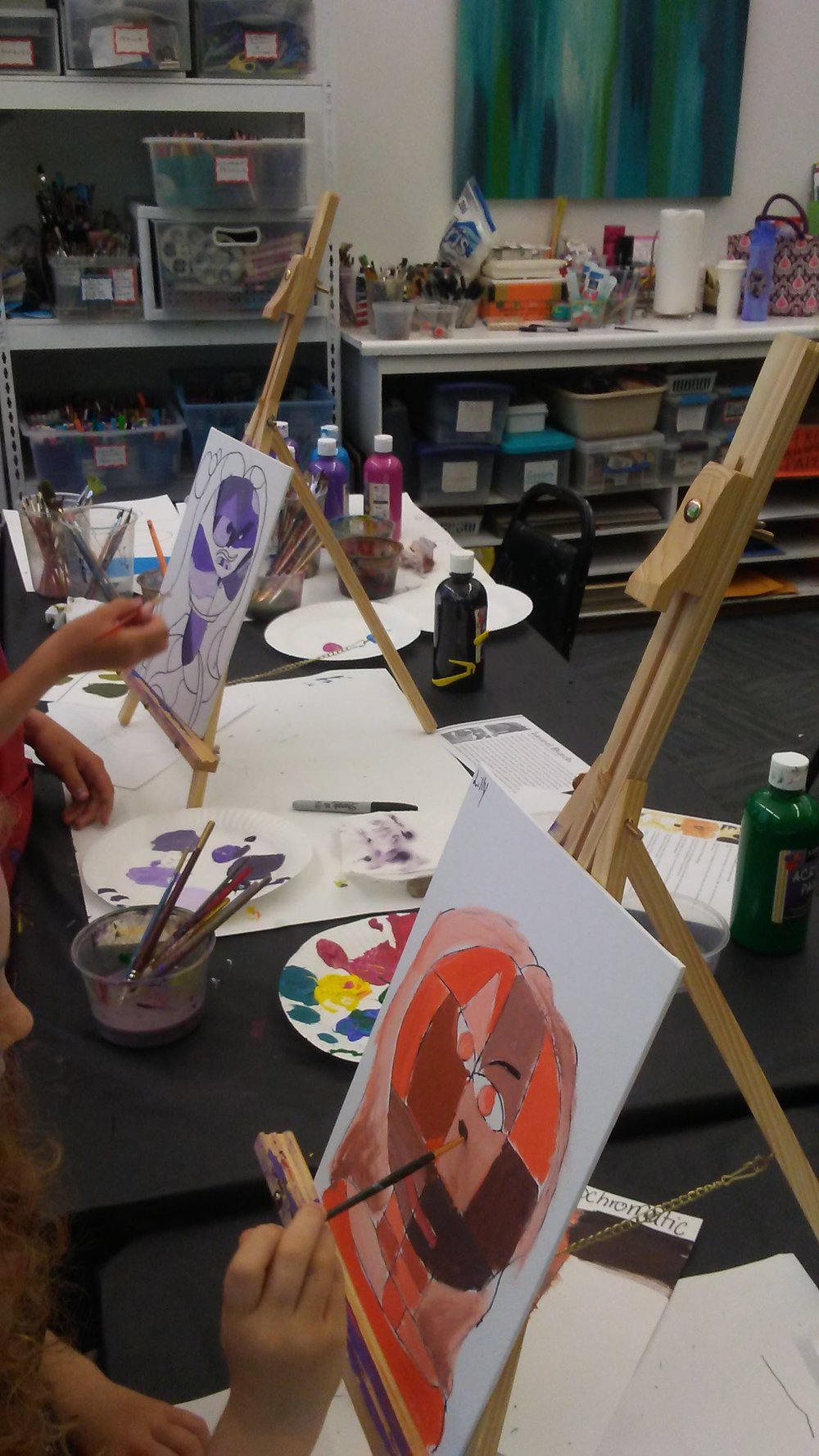 Students creating a self-portrait Klee inspired and monochromatic.