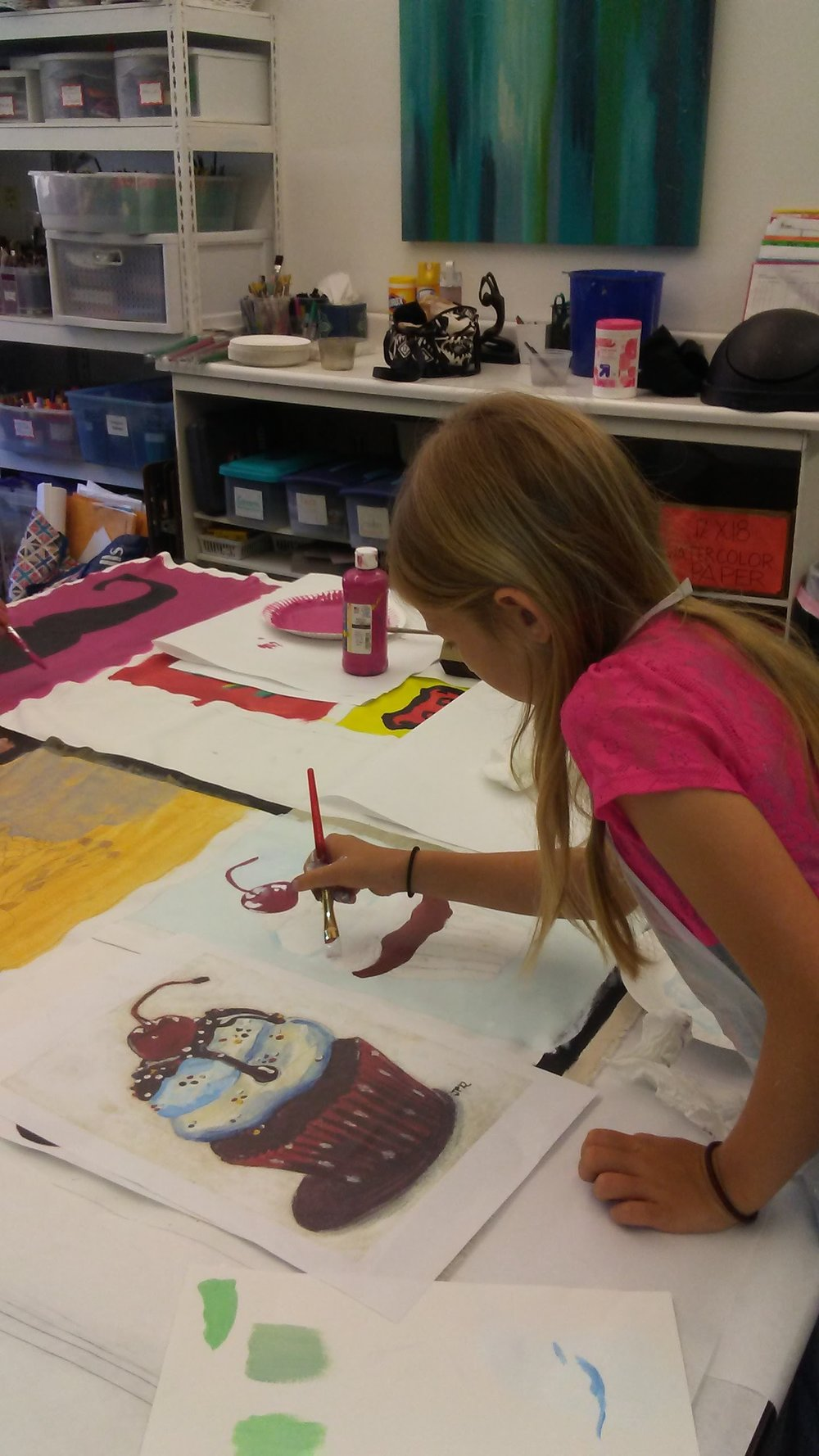 Students working on mural with acrylic paint (first time).