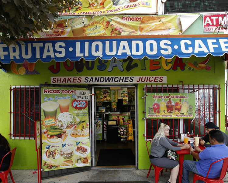 "In a time when cold-press juiceries are relentlessly on trend, and often relentlessly expensive, Jugos Azteca in Highland Park is keeping juices old-school. For the last 21 years, the tiny juice shop on York Boulevard has been making Mexican-style fruit and vegetable juices, smoothies, tortas, tostadas, Mexican-style gelatin and other simple Mexican snacks for the Latinos who've lived in the neighborhood for decades, as well as some of the newer residents who appreciate the value and the flavors of the fresh and colorful drinks.  ""We have customers who are waiting for us to open at 5:30 a.m. every day to get a green juice for breakfast and then a torta for lunch before they go to work,"" said the shop's owner, Efrain Peña, 44, in Spanish, as he took a break from recording his daily sessions on  Instagram .  The small, neon-green building that houses Jugos Azteca stands out from the rest of the neighborhood's newer style of muted colors. Signs advertising everything from ""Ricas Tostadas"" to ""Diablitos"" and the red tables and chairs outside are as colorful as the juices themselves."