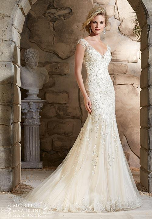 40% off sample gown- Now$960.00  - Was $1600.00Size- 6light goldDesigner- MorileeStyle# 110221