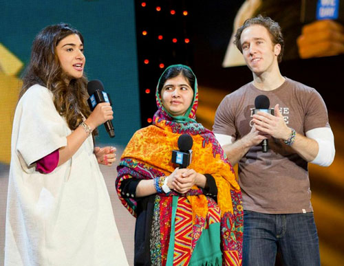 Now a celebrity! Malala Yousafzai took to the stage to make an exciting announcement on March 7th, 2014 at We Day UK. (Photo: WeDay.org)