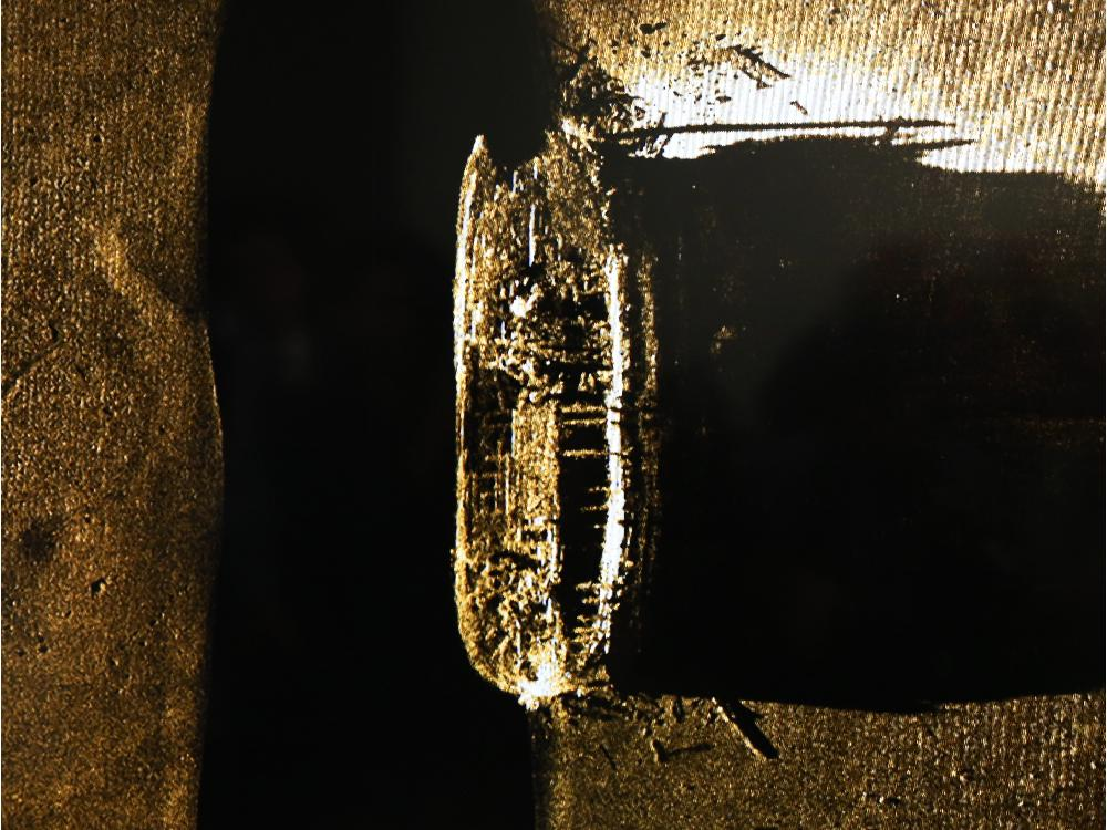 Canada's Prime Minister, Stephen Harper unveils an image of one of the ships belonging to the ill-fated Franklin Expedition which was lost in 1846 PHOTO: Jean Levac / Ottawa Citizen