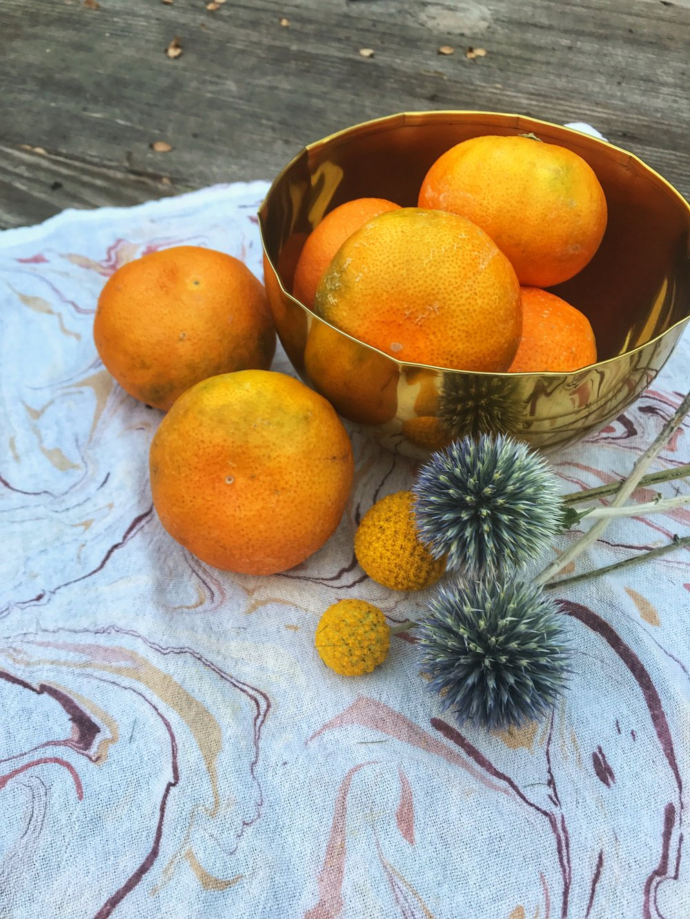 bowl of oranges and flowers