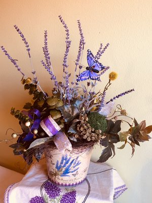 Silk lavender blue floral artistry a small bids nest is a signature trait of lavender blue floral a butterfly hovers over the flowers and adds to the uniqueness of the arrangement mightylinksfo
