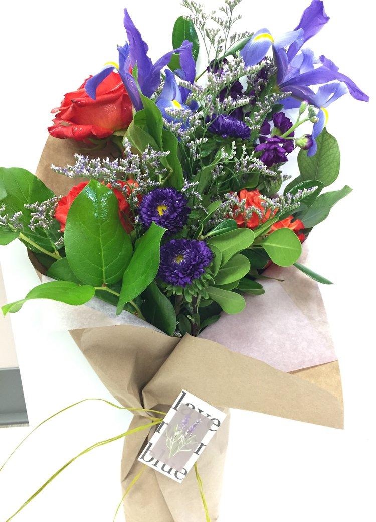 Wrapped flower bouquet lavender blue floral artistry wrapped flower bouquet mightylinksfo