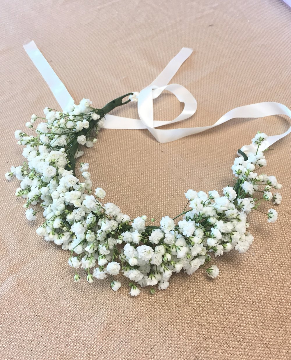 'Happy Clouds' crown: Adjustable baby's breath crown, encircles the head.White ribbons tie at the back.Let us know age of wearer and we can make adjustments.