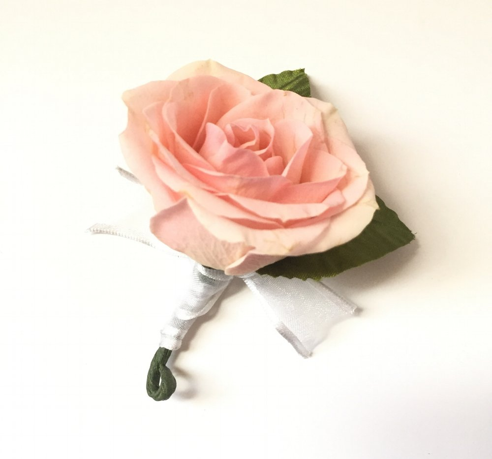 Classic Bouts: Simple and classis style of bout with single spray rose and 2 silk leaves , wrapped in sheer white ribbon with edging. Comes with magnet.