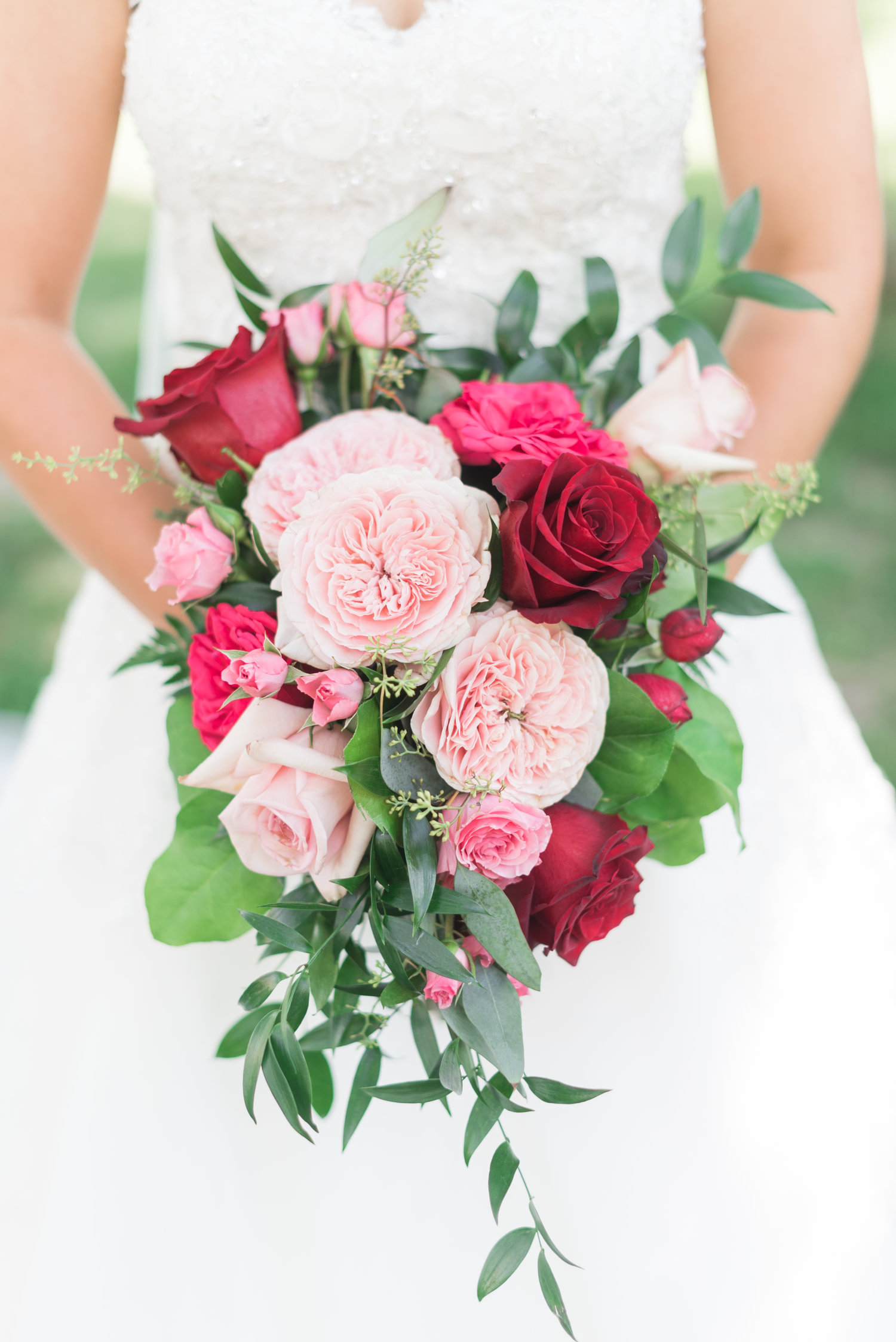 Des Moines wedding florist eucalyptus and pink roses, red flowers, light pink bouquet