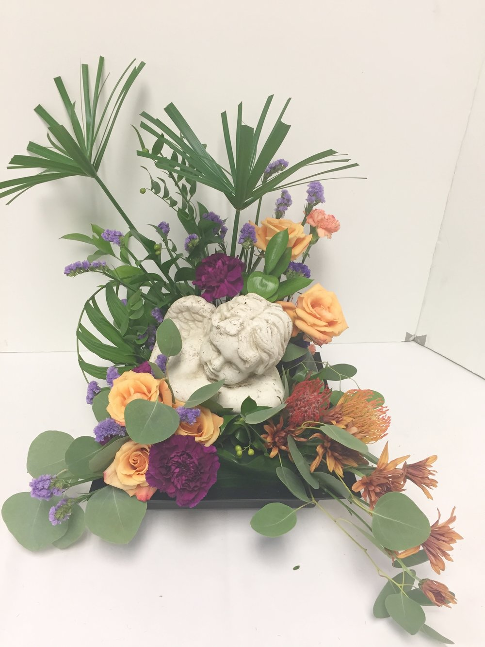 Sympathy lavender blue floral artistry des moines sympathy flowersangel memorial flowersangel memorial statue izmirmasajfo