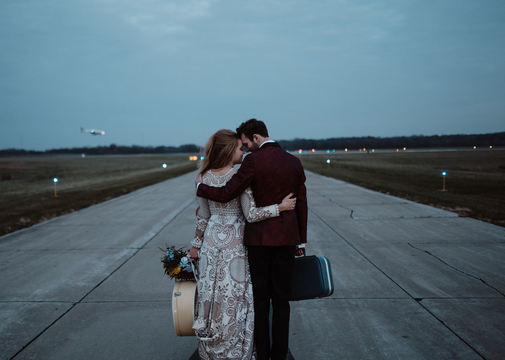 walking together des moines elopement at small airport