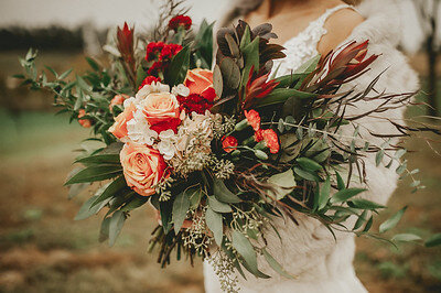 Large, loose , Boho bouquet from Lavender Blue with red and coral roses and eucalyptus