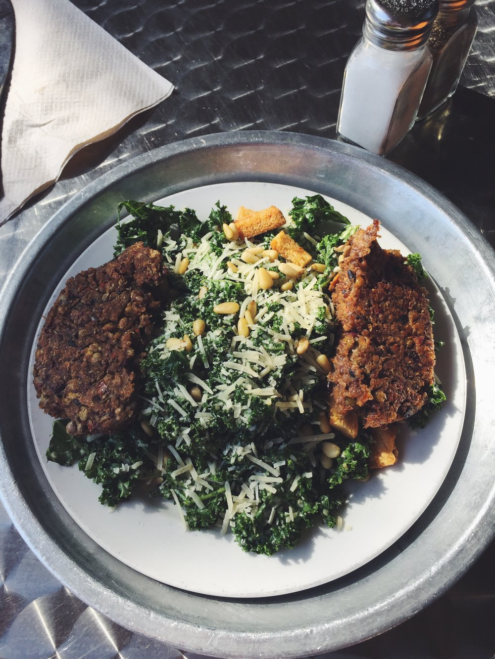 Kale Caesar Salad with a silo burger patty from City Silo