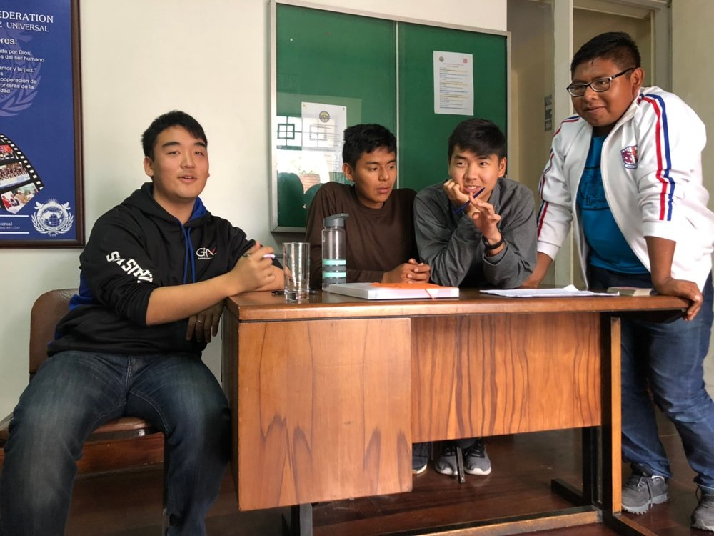 5.13 - brothers at desk.jpg