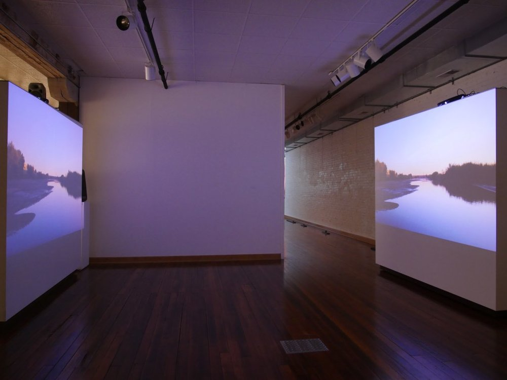 A two-channel video installation shows a vista of the Rio Grande, which helps mark the U.S.-Mexico border. Image courtesy of the artists.