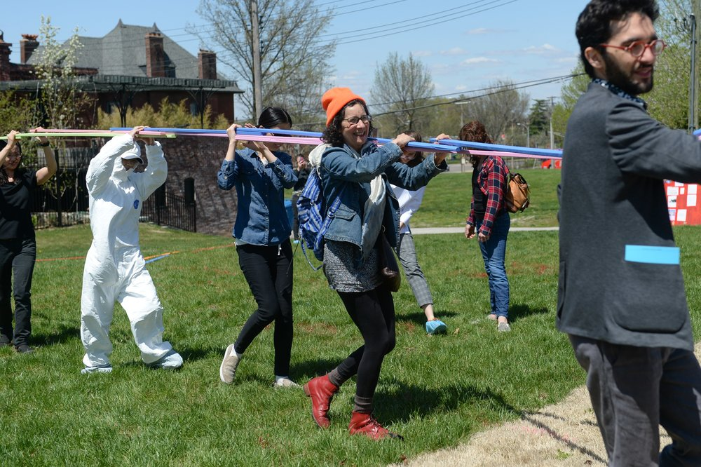 """Participants in Eric Ellingsen and Species of Space, """"the earth is blue like an orange (landscape performances welcoming the future now Chouteau Greenway),"""" 2018, presented as a part of Dwell In Other Futures: Art / Urbanism / Midwest. Pulitzer Arts Foundation, St. Louis. April 28, 2018. Photo by Michael Thomas."""