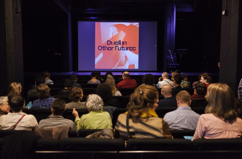 """Audience members sitting in a theater during """"The Autumnal City: Conversations with Samuel R. Delany,""""presented as a part of Dwell In Other Futures: Art / Urbanism / Midwest. .ZACK, St. Louis. April 27, 2018. Photo by David Johnson."""