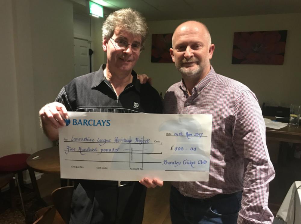 bush presents a donation to the lancashire league experience