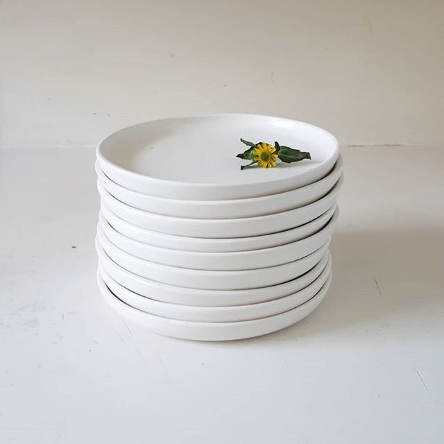 a small stack of a recently completed custom porcelain dessert plates with a satin white glaze 🌻
