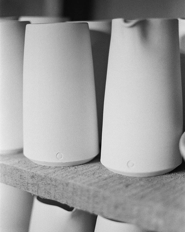 A shot in the dark (basement) I took during the OOAKS18 show prep with Brendan's film camera. Bisqued tumblers and pour cups waiting to be fired. . Today I'm hanging out with a sinus cold. I hope you are having a better Tuesday! 😣🌻