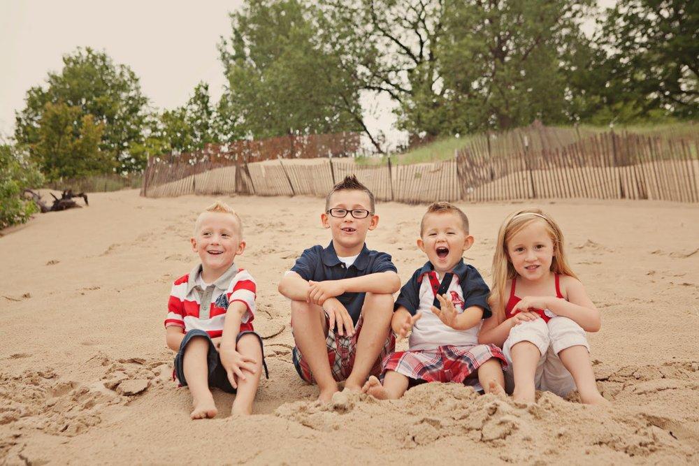 Kids sitting on beach.jpg