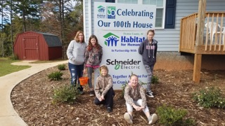 The Crane family in front of their new Butler School Road home.