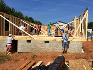 - Schneider Electric employee volunteers built and raised three walls in four hours