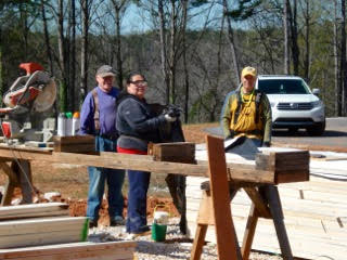 "- The ""Cut Team"" keeps cut lumber coming for the carpenters"