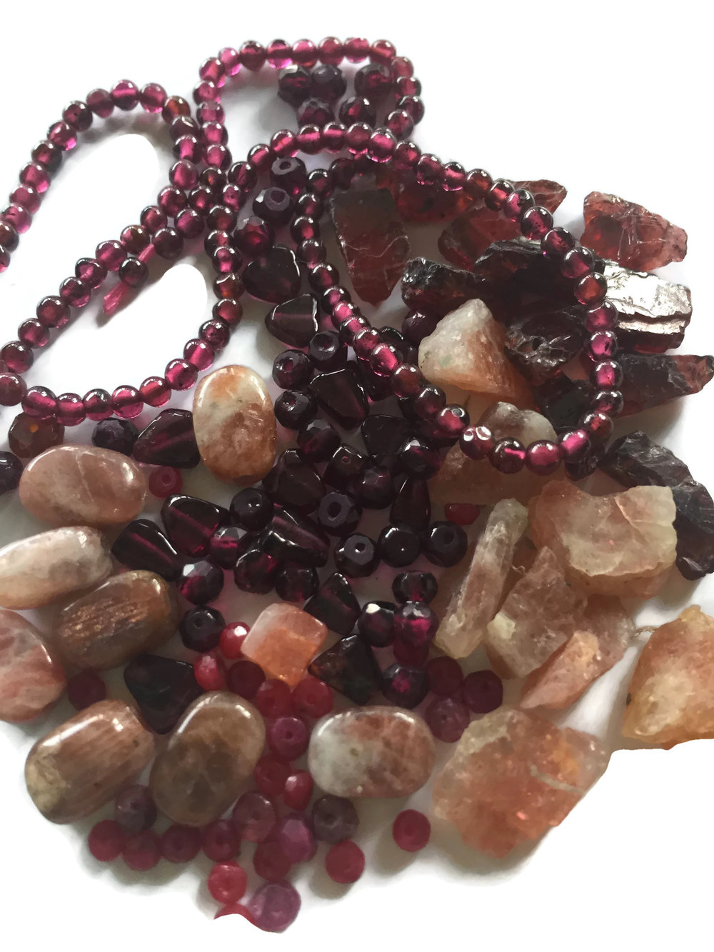 the Sun's gems bestow warmth + strengthen will + promote independence + helps with circulation + increase digestive fire - Gems: Ruby, Garnet, Star Ruby, Red Spinel, Red Zircon, Red Tourmaline, Sunstone, Rose Quartz