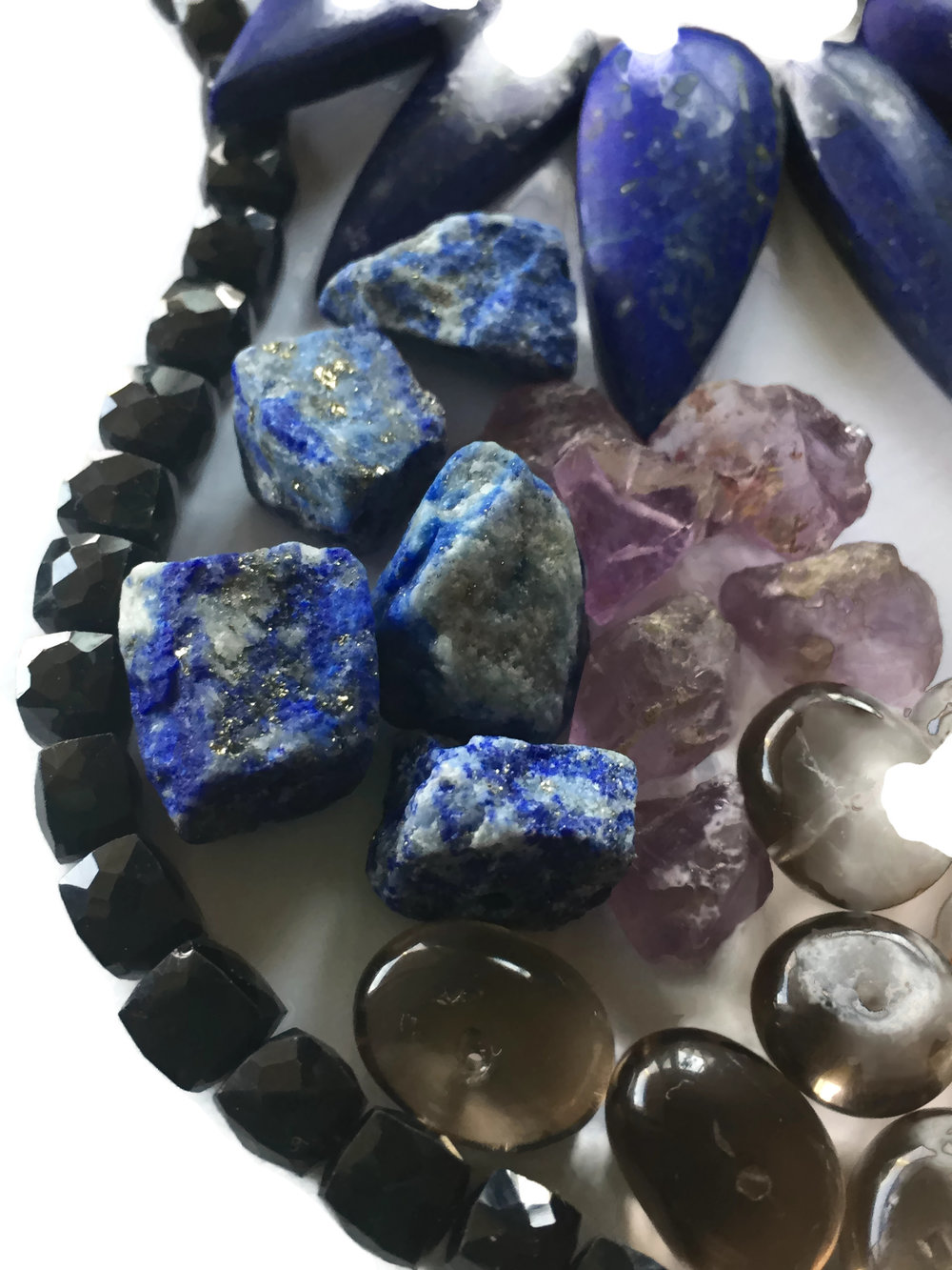 Saturn's gems protects one on travels + fights addictions + wards of negative energies + connects you to Spirit - Gems: Blue Sapphire, Blue Zircon, Amethyst, Lapis Lazuli, Blue Spinel, Black Onyx, Smokey Quartz