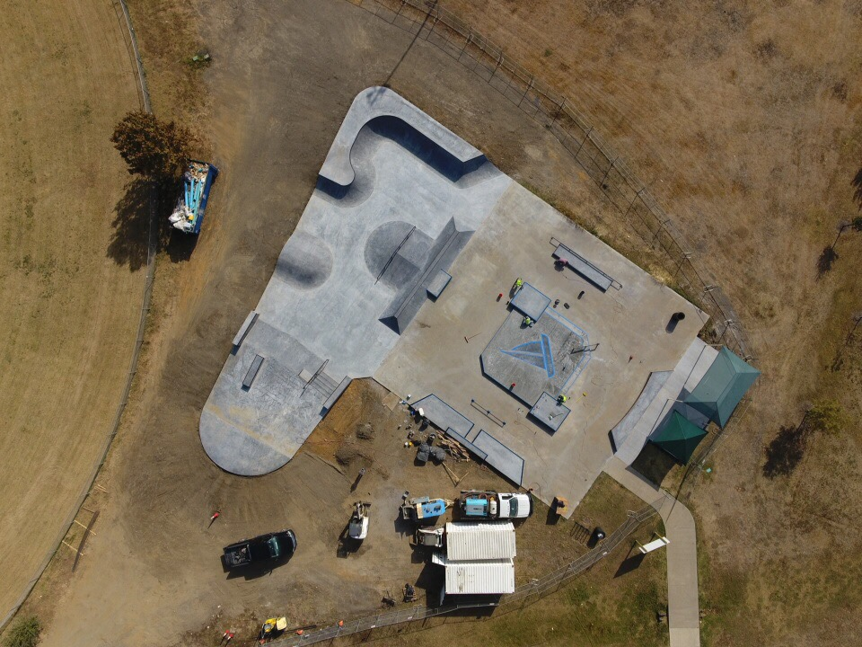 Working with New Line / SPA, The Colony reused its existing concrete slab to gain cost efficiencies, and designed a beautiful park. They were able to expand the park to about 12,000 sqft as part of this redesign, and incorporate local attributes like the sailboat to indicate the proximity to the lake. This drone photo was taken before completion of construction. The redesigned park opened December 16, 2017.