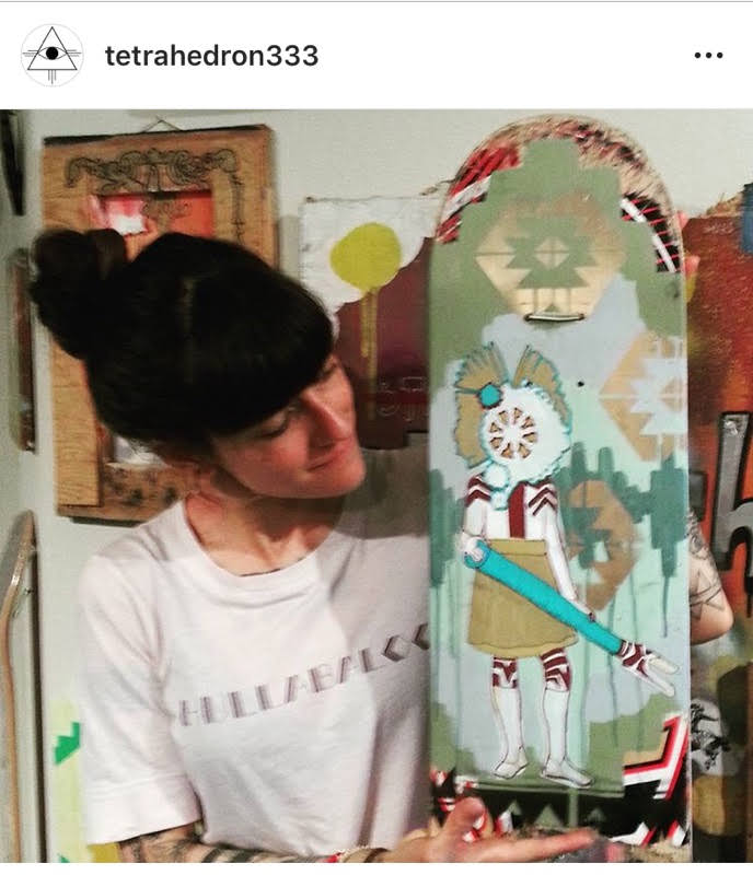 Kelly with donation skateboard