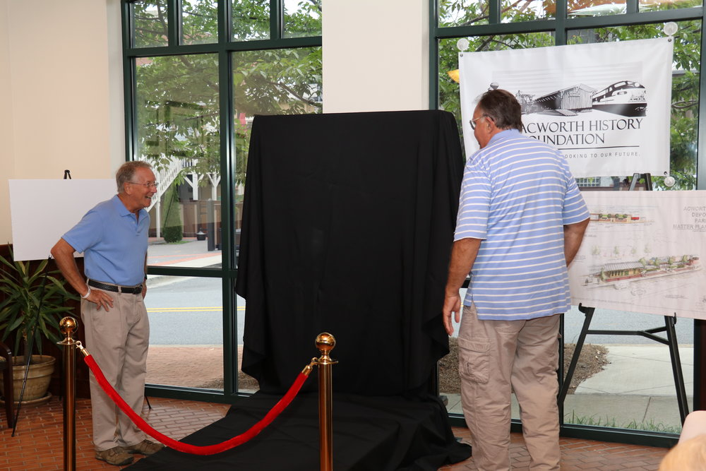 The Mayor and Moose McCray figure out the Unveiling