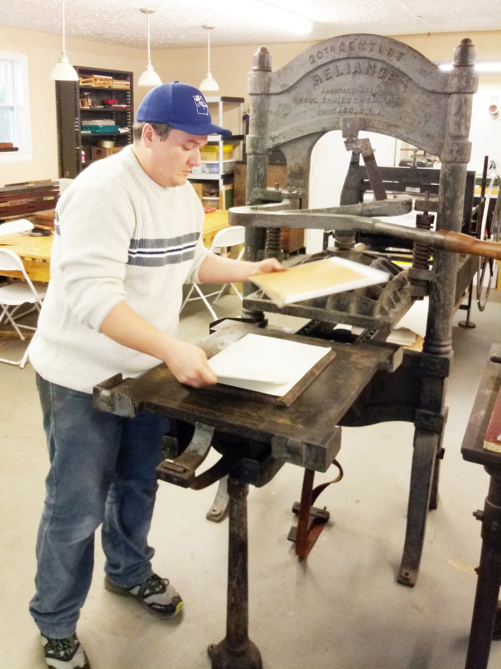 Executive Director and Master Printer, Nuno Nunez checks the print