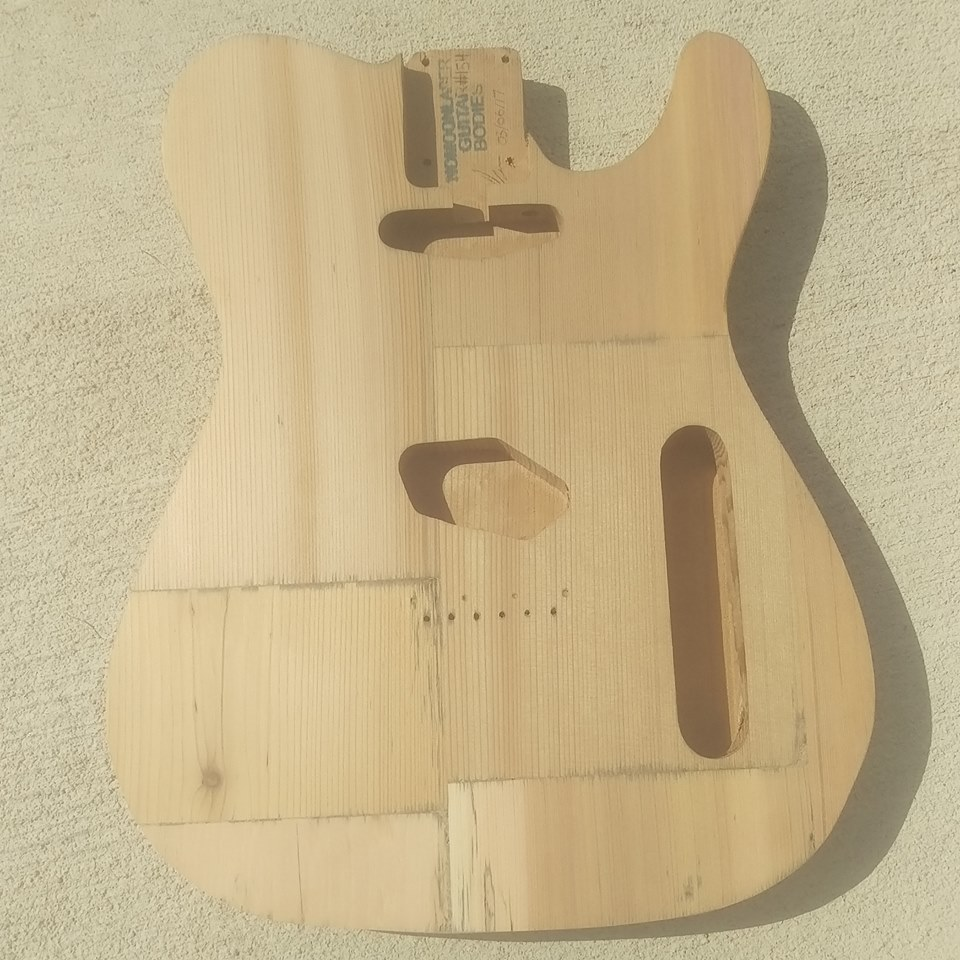 This cedarcaster body came from a barn in Omaha, Nebraska. The reclaimed wood was reassembled and carved into this body; here it is before the stain.