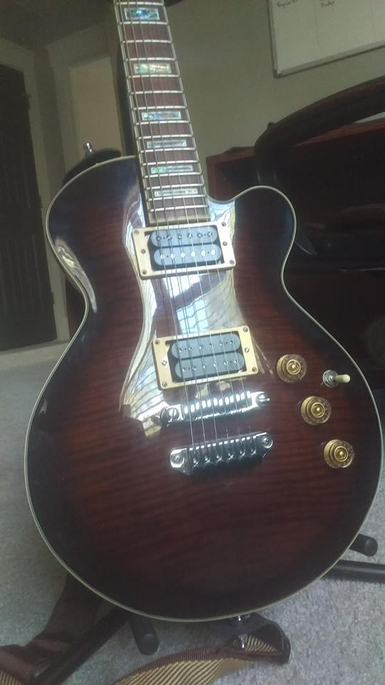"""An Ibanez ARC300 in Violin Burst; Dimarzio PAF (neck) and Dimarzio Super Distortion (bridge). This model was only made for a year or two around 2007, before being discontinued in favor of the ART series with sharper cutaways and hotter stock pickups - a more """"metal"""" approach. These cover the whole spectrum a bit better, from jazz, to country, to hard rock and even heavier genres with the right electronics."""