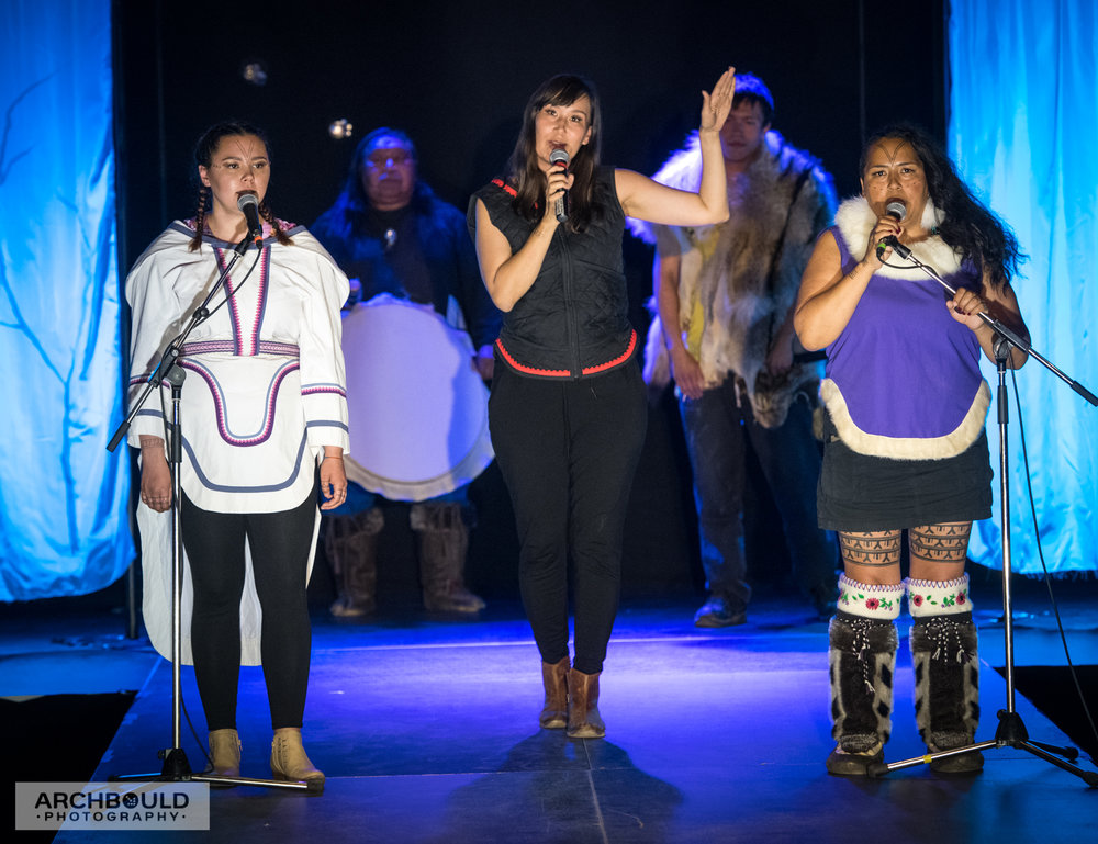 Adäka Circumpolar Collaboration, July 2018, featuring Aasiva (NU), Nive Nielson (GL), Mathew Nuqingaq (NU), Hovak Johnston (NWT) and John Stosh (YT). Photo by Cathie Archbould (courtesy of Adäka Cultural Festival).