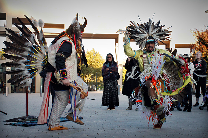 Carl Moore and Mason Runsthrough perform a traditional victory dance to honor Salt Lake City's first Indigenous Peoples' Day. October 9th 2017