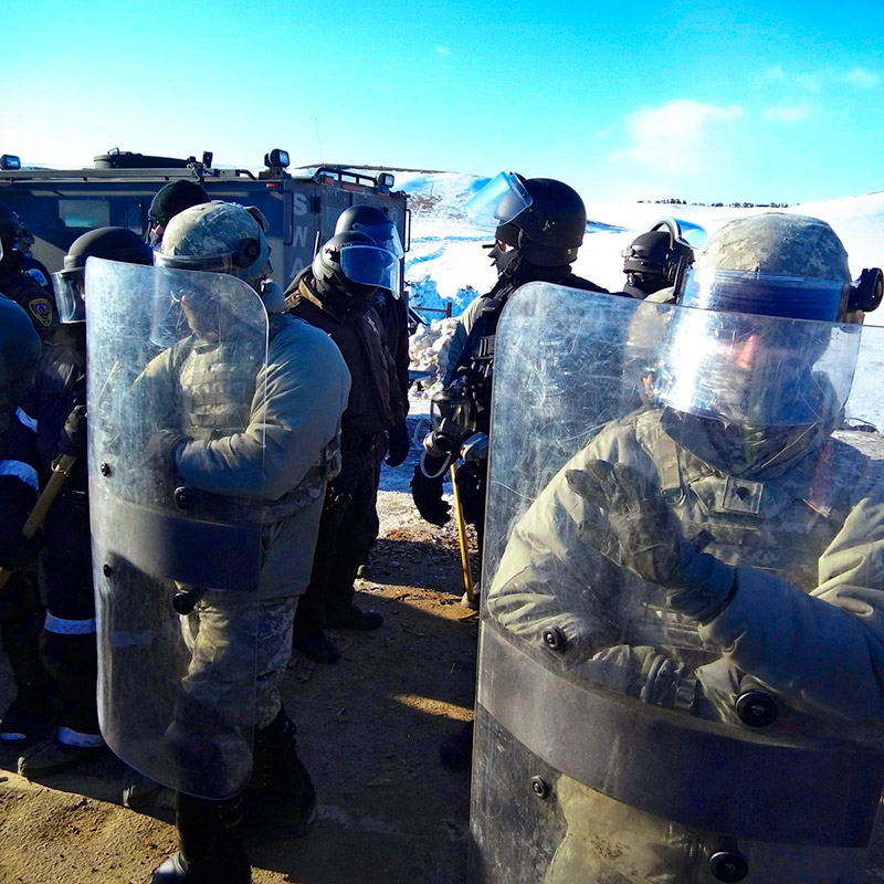 Morton County Sheriff's deputies prepare to face off against Dakota Access Pipeline protestors, near Cannonball, North Dakota. Photo by Frontline volunteer William 'Billy' McMaster.