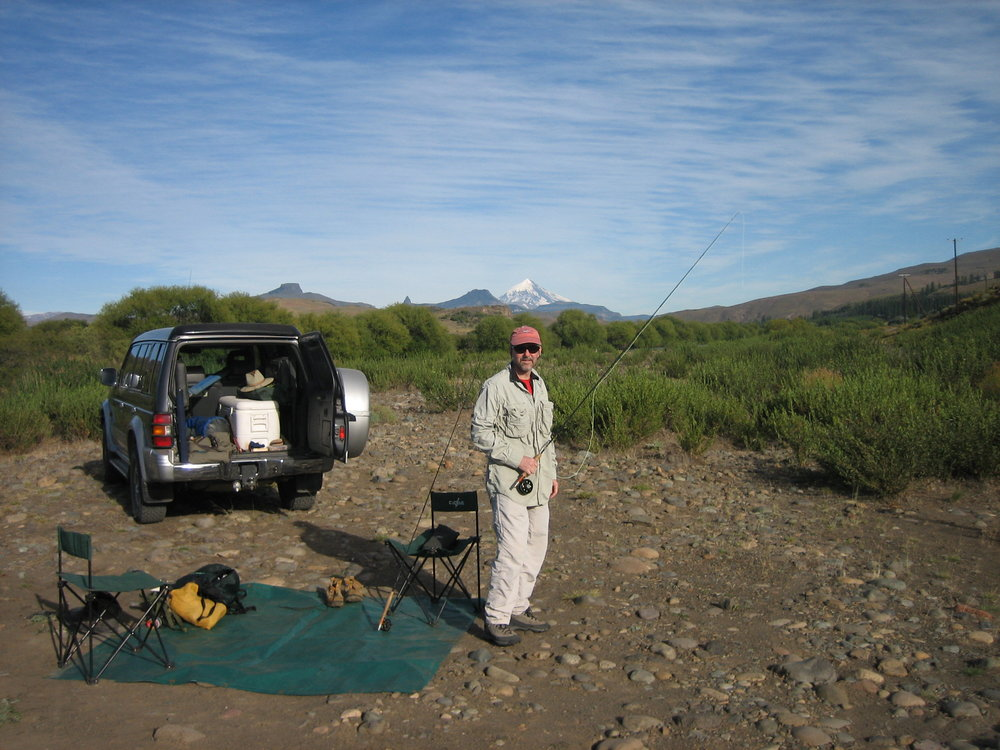 Gearing up to step in the Malleo River for the first time. Lanin volcano is just over your shoulder everywhere you fish in northern Patagonia.
