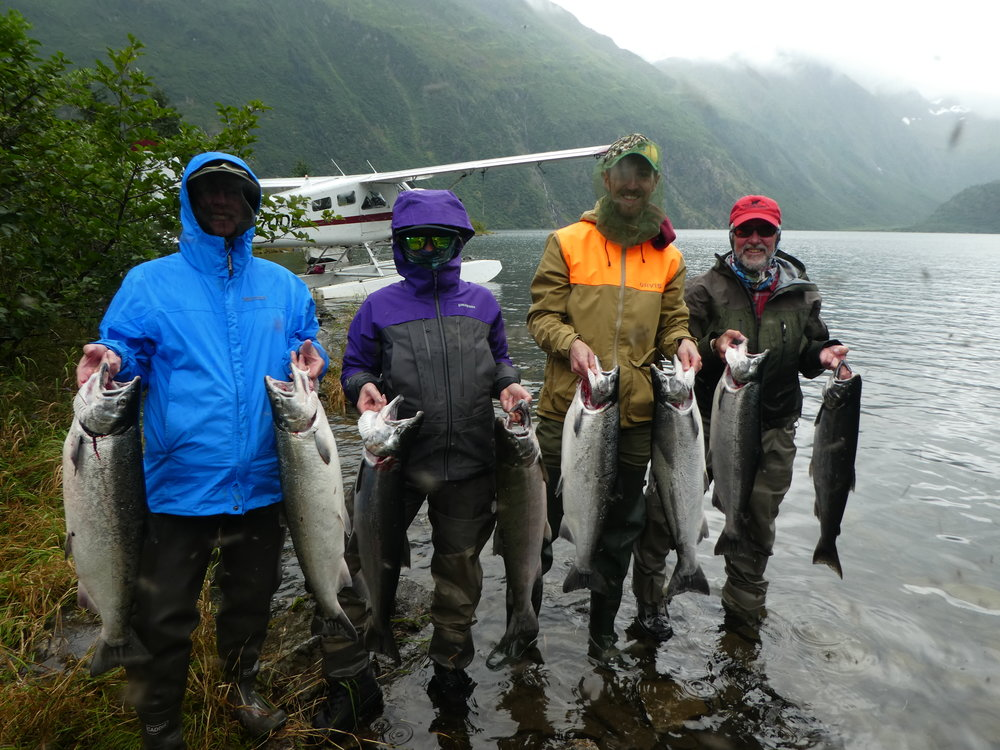 A successful family fishing adventure. We caught silver salmon that were as anxious to bite as the epic swarms of flies (note the head nets)!
